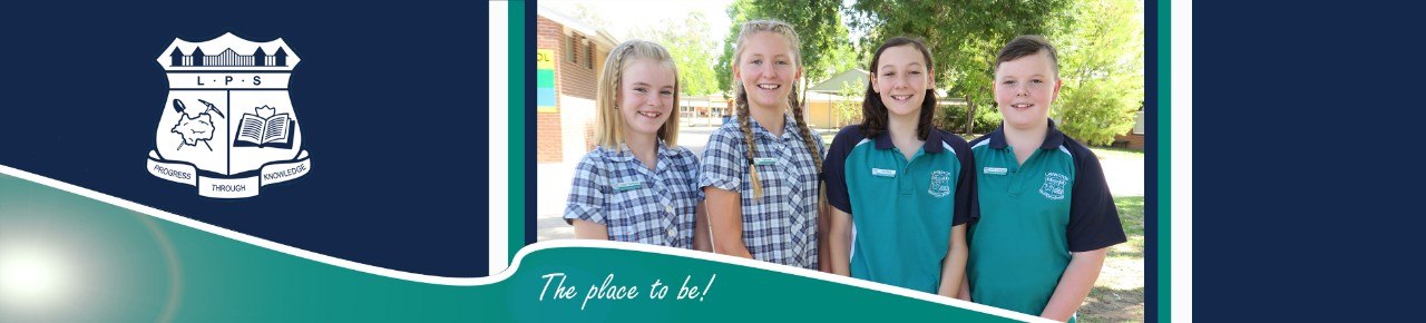 Photo of our 2019 student leaders smiling in school uniform